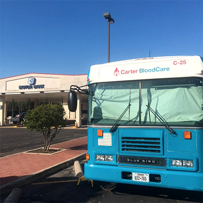Blood drive bus parked in front of the bank's Downtown location